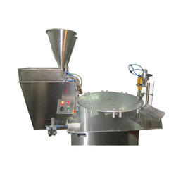 Rotary Semi Liquid Filling, Plugging and Capping Machines