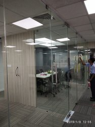 Glass Partition With Patch Fittings