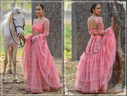 Amusing Net Embroidered Party Wear Lehenga Choli