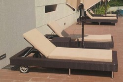 Movable Wicker Pool Lounger