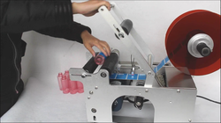 Semiautomatic Round Bottle Sticker Labeling Machine