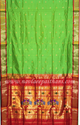 Fluorescent Green With Red Contrast Boarder In Single Pallu Paithani Silk Saree.