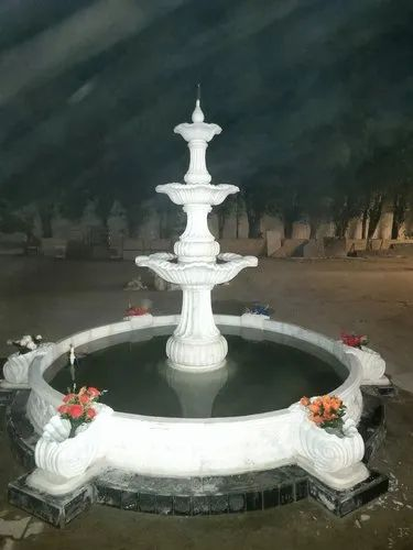 White Marble Fountain With Water Body