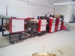 Roll to sheet cutting machine for packaging line