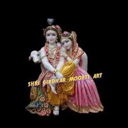 Marble seating radha krishna statue