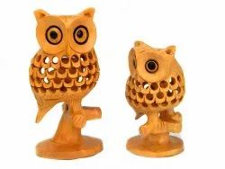 Wooden Owl Standing on Branches