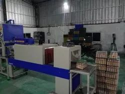 SOFT DRINK BOTTLE PACKING MACHINE
