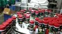 Automatic Container Filling With Inner Capping And Outer Capping