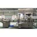 Linear Bottle Filling and Capping Machine