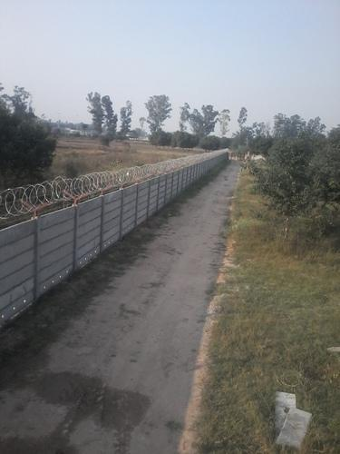 Boundary Wall With Concertina Coil Fence