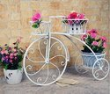 Wheel Pot Stand In Metal