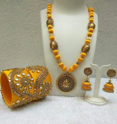 Yellow with ganesh antique pendant silk thread jewellery set at rs yellow with ganesh antique pendant silk thread jewellery set mozeypictures Gallery