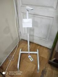 Foot activated sanitizer dispense