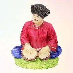 Man Tabla Statue