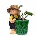 Little Girl Holding Planter