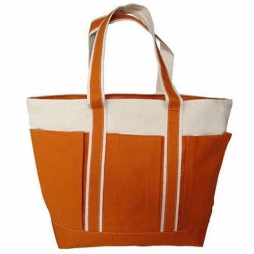 32264a0cf0 Orange And White Plain Cotton Carry Bag