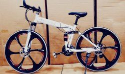 White Mercedes Benz Folding Cycle