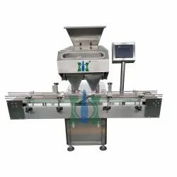 Electronic Multichannel Capsule Counter And Filler