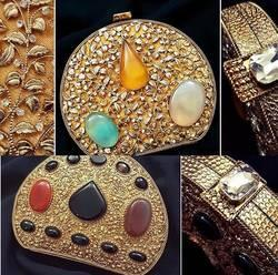 Brass and Ruby Clutches