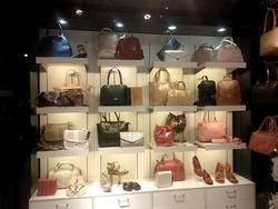 Purse Display on Slatwall Panel
