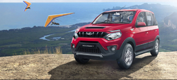 Red Mahindra NuvoSport Car