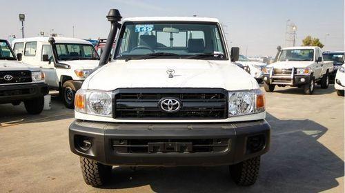 White Toyota Land Cruiser Pickup