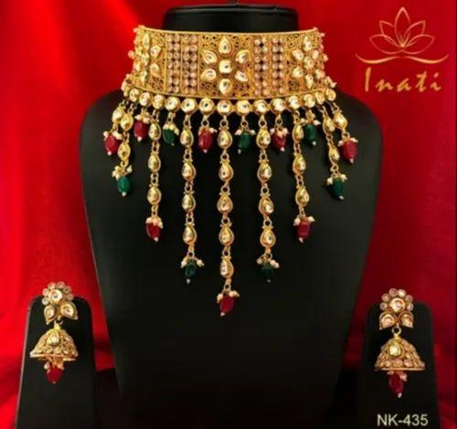 Gold Finished Kundan Jewelry Pearl Necklace, Jhumki, Sahare Earrings And Stud Tikka By Jewel India