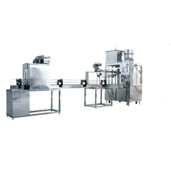 Rotary Bottle Filling And Capping Machine