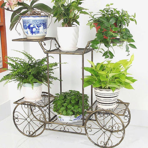 Polished Wrought Iron Planter Stand प ध क स ट ड