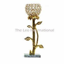 Golden finish floral shape candle holder with crystal votive
