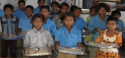 Distributing School Text And Notebooks To Poor Students