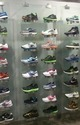 Shoes Display On Glass Panel