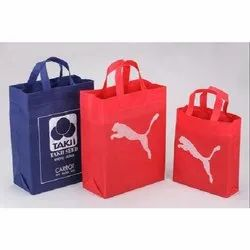 Printed Non Woven Loop Handle Carry Bag, Capacity: 50 kg