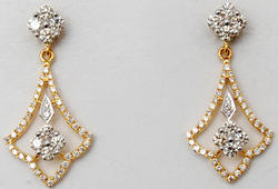 two tone gold subtle trendsetting prong set diamond clustter  earrings