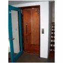 Blue Glass Swing Elevator Door