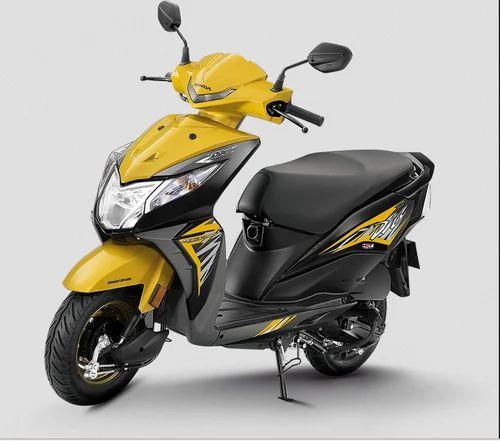 Dazzle Yellow Metallic And Pearl Igneous Black Honda DIO