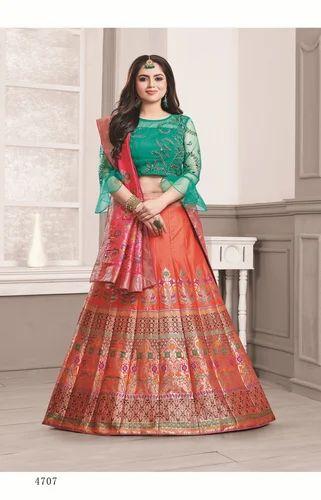 f92da8dc52 Semi-Stitched Dark Orange Banarasi Silk Lehenga with Designer Green Choli