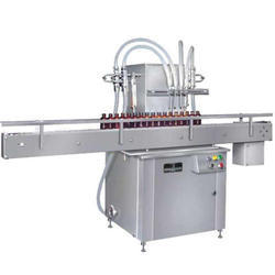 Aim Technologies Fully Automatic Liquid Filling Machine, Capacity: 20 to 30 jars/min