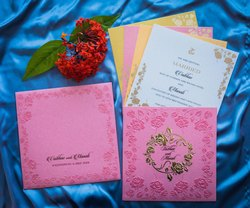 Pastel Pink Marriage Invitation Card Design With embossed floral design