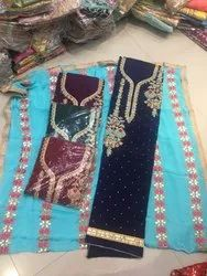 Party Wear Ladies Peach Heavy Embroidered Unstitched Suits