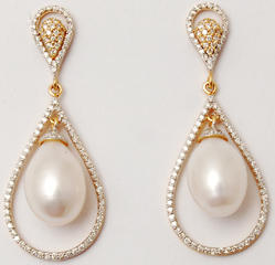 brilliant  diamond studded pearl centered pear shaped drop earrings