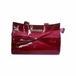 Taurus Enterprises Maroon Ladies Fancy Handbag