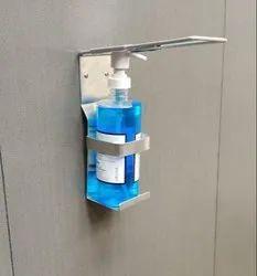 Elbow operated sanitizer dispenser