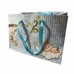 Blue and White Printed Paper Carry Bag