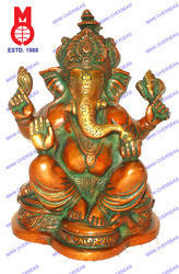 Ganesha Sitting On Decorative Statue