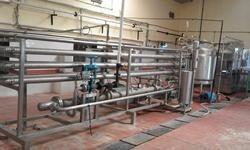 Food Processing Guru Engineers Fruit Juice Pasteurizer, Automatic Grade: Automatic, Capacity: 500 Kg