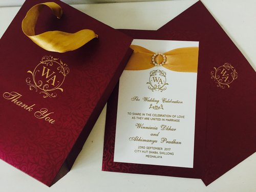wedding invitation with ribbon and rhinestone