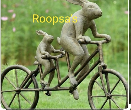 Cycling Rabbit Statue For Garden