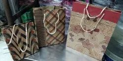 Printed Designer craft Paper Bags, Capacity: 1 to 5 Kg, Packaging Type: Plastic Bag