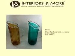 Interiors & More Glass Handle Jar with Top Curve